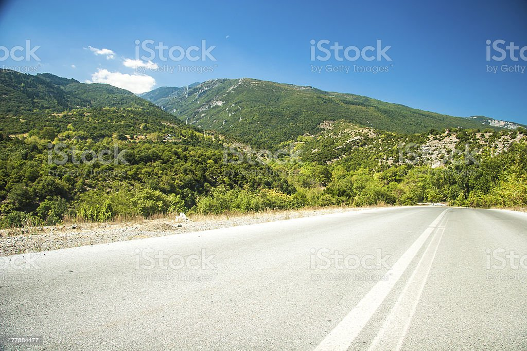 Road in mountain range at Olympos Mountains royalty-free stock photo