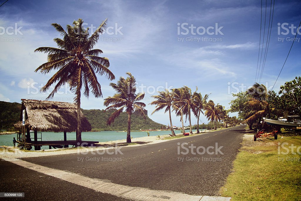 Road in Pohnpei with Sokehs rock in the background stock photo