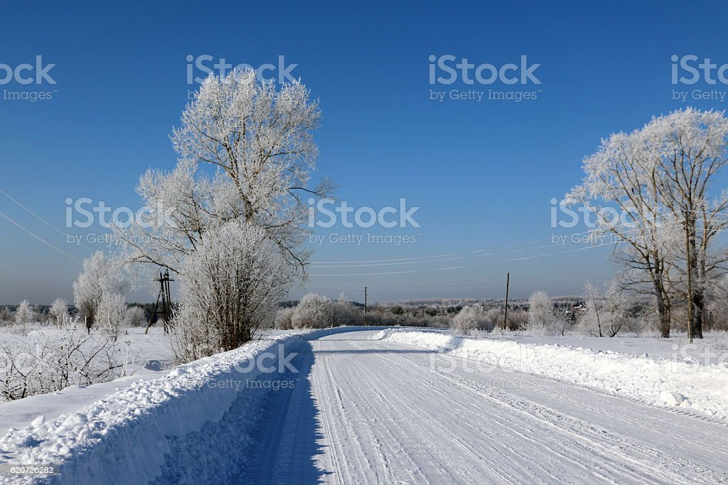 Road in snow in cold winter day stock photo
