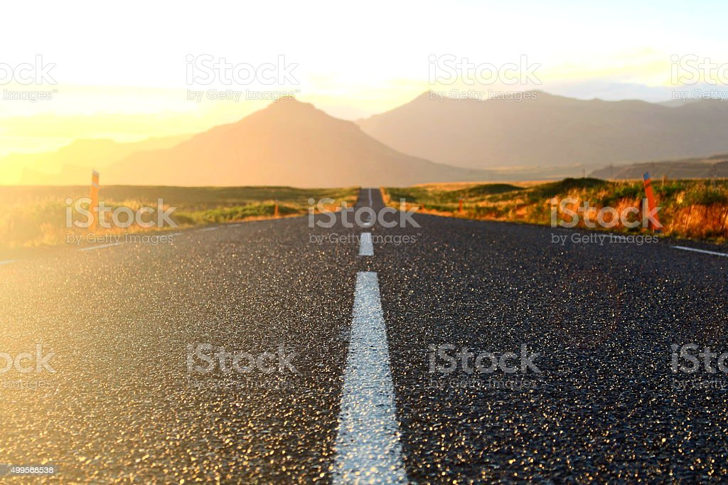 Road in the Icelandic evening sun stock photo