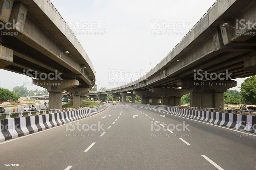 Road in the middle of overpasses stock photo