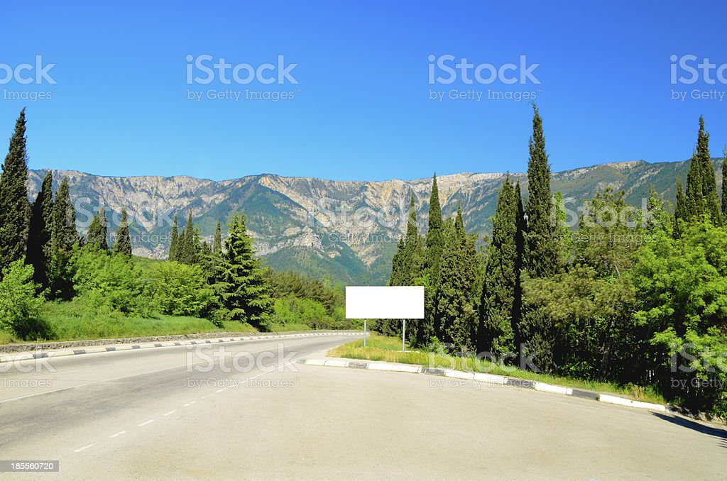 road in the mountains of spruce and cypress trees royalty-free stock photo