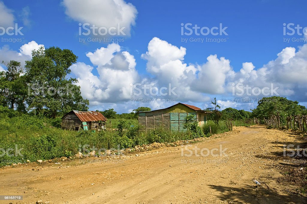 Road in the village under blue sky stock photo
