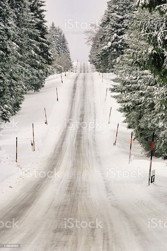 road in winter mountains stock photo