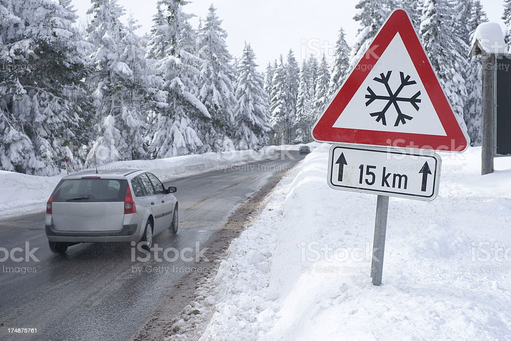 Road in winter with traffic sign royalty-free stock photo