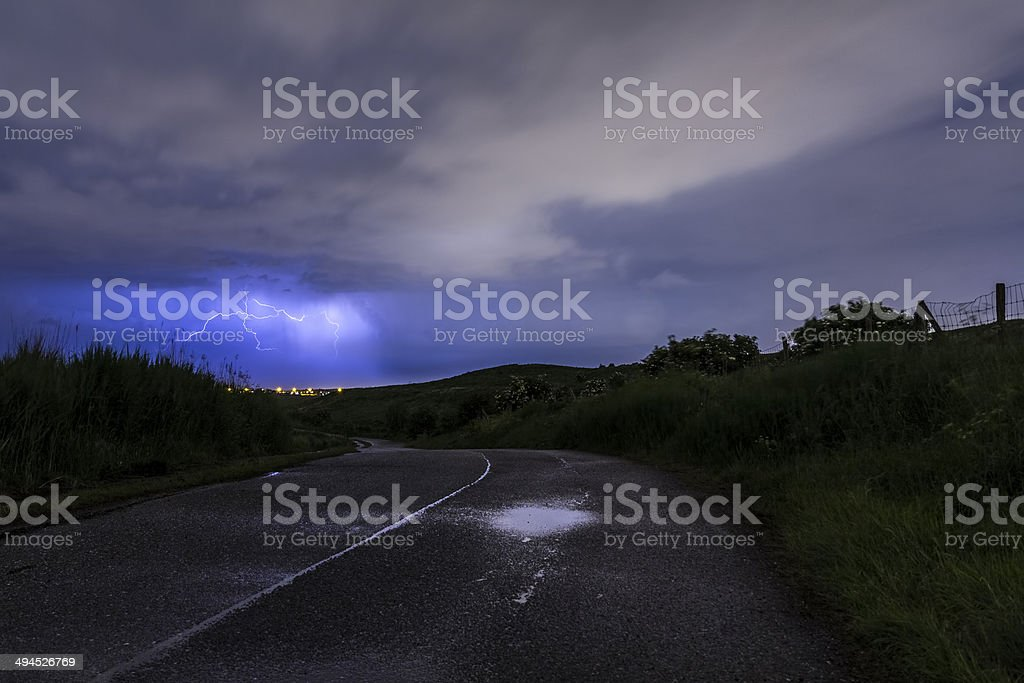 Road into the storm stock photo