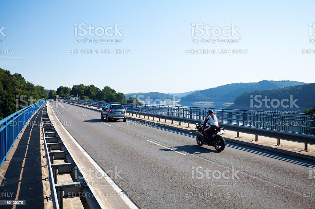 Road L 512 and bridge at lake Biggesee stock photo