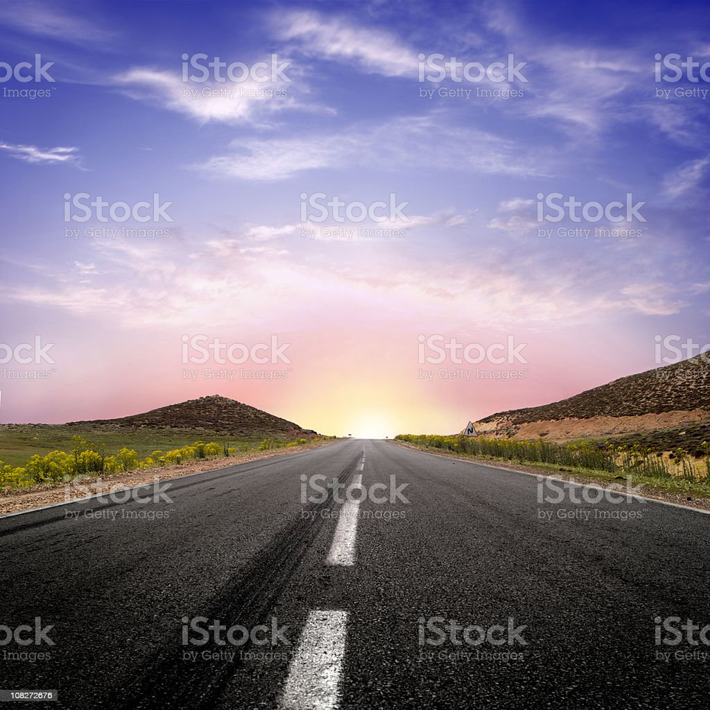 Road Leading to a Sunrise stock photo