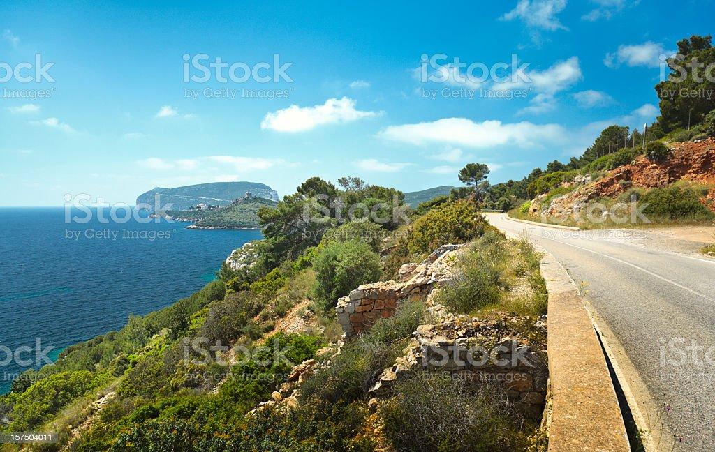 Road leading to Capo Caccia on Sardinia, Italy. stock photo