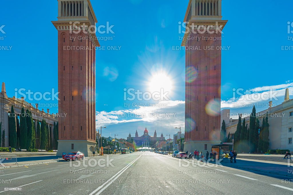 Road Leading Towards Venetian Towers Against Sunny Sky stock photo