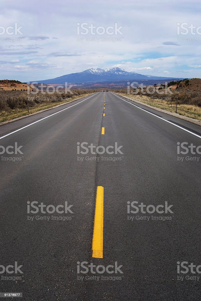 road leads to the distant mountain landscape stock photo
