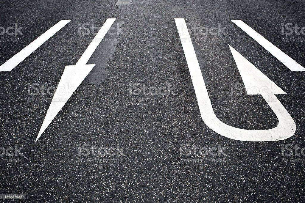 Road Marking, arrow signs - U-turn stock photo