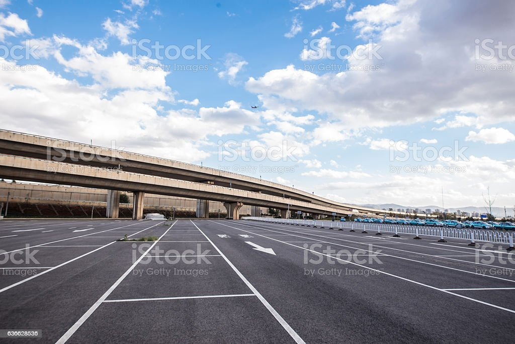 Road marking on the asphalted parking place stock photo