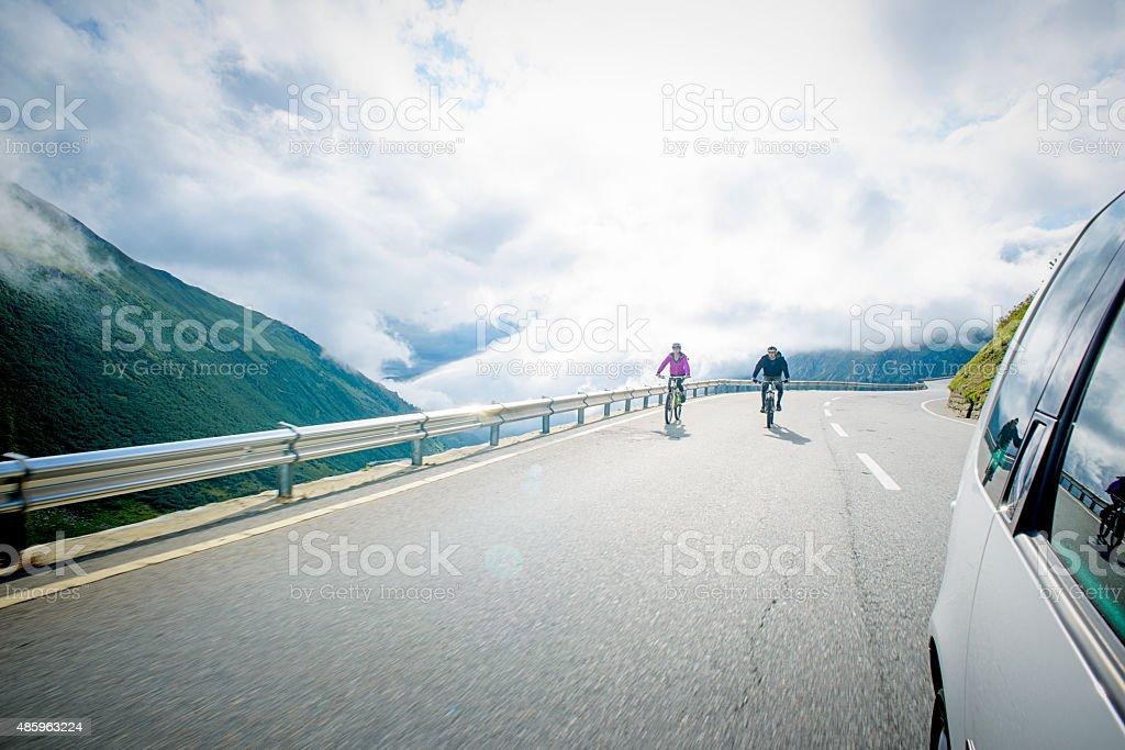 Road Mountain Biking Downhill in the Swis Alps stock photo