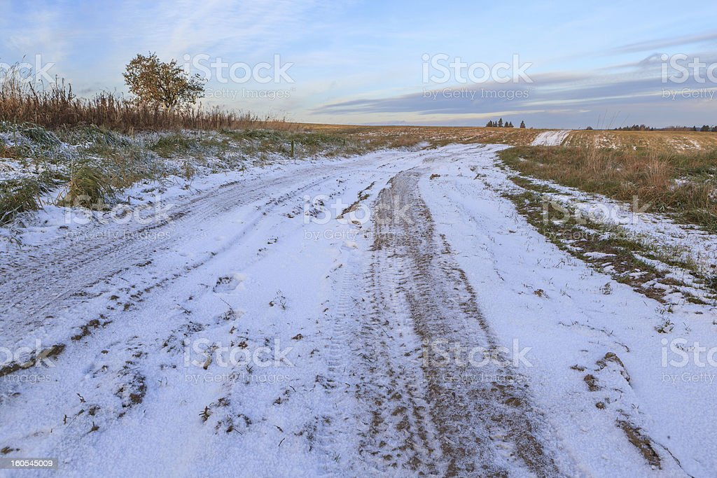 Road on a snow-covered field royalty-free stock photo