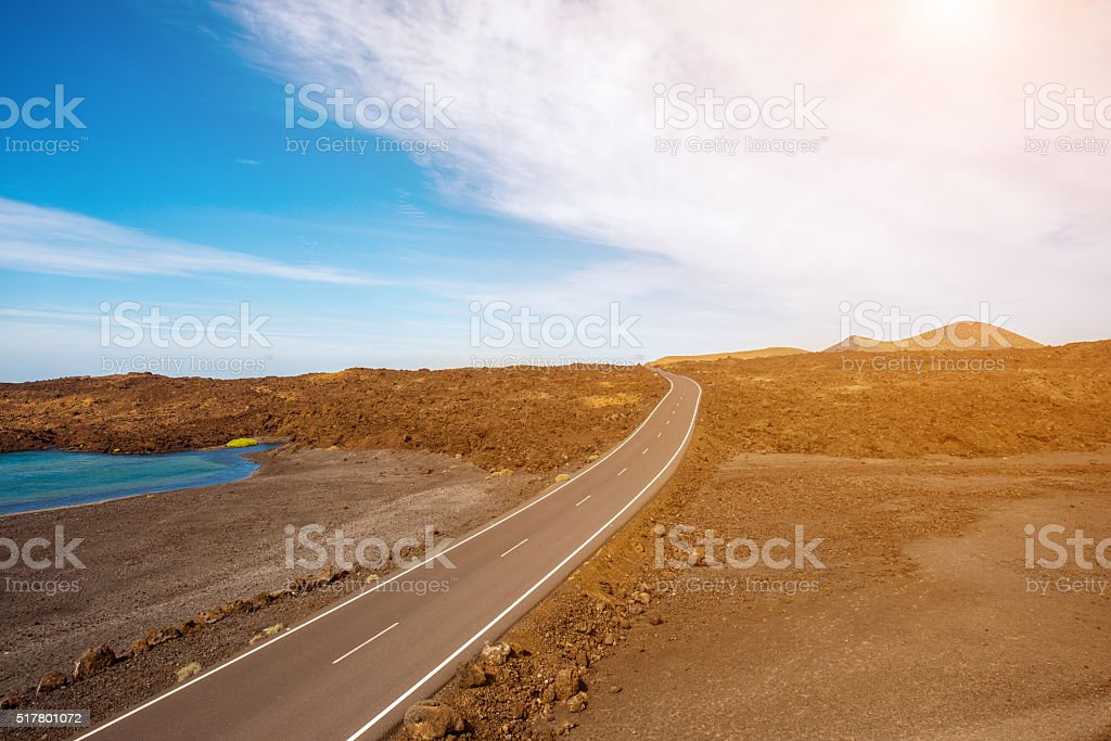 Road on the deserted landscape stock photo