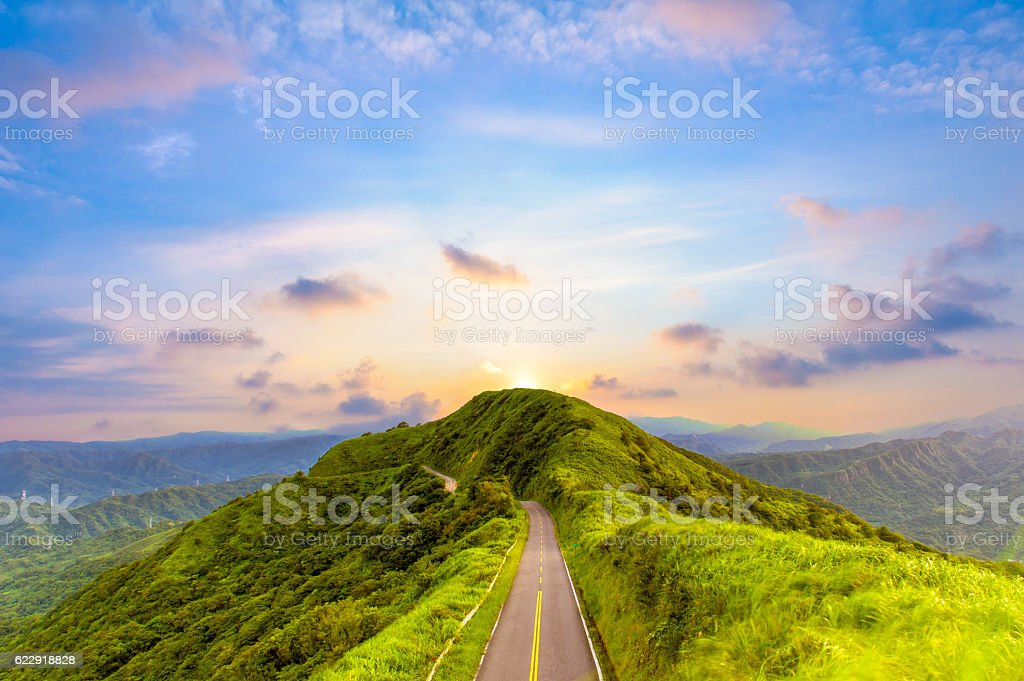 road on the peak of hill stock photo