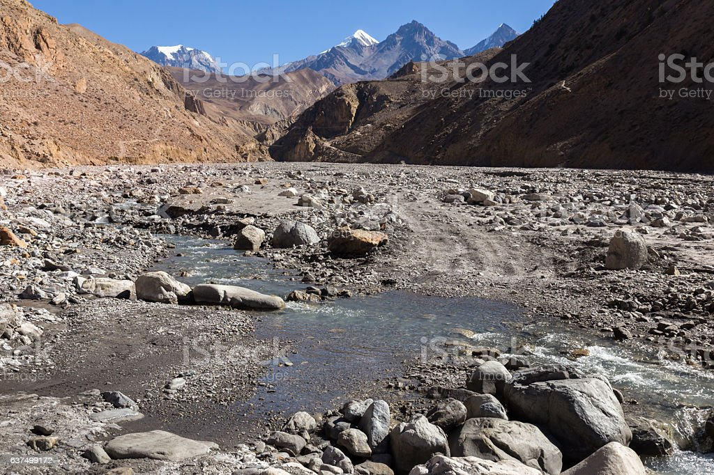 road over a stream in mountain gorge, Himalaya stock photo