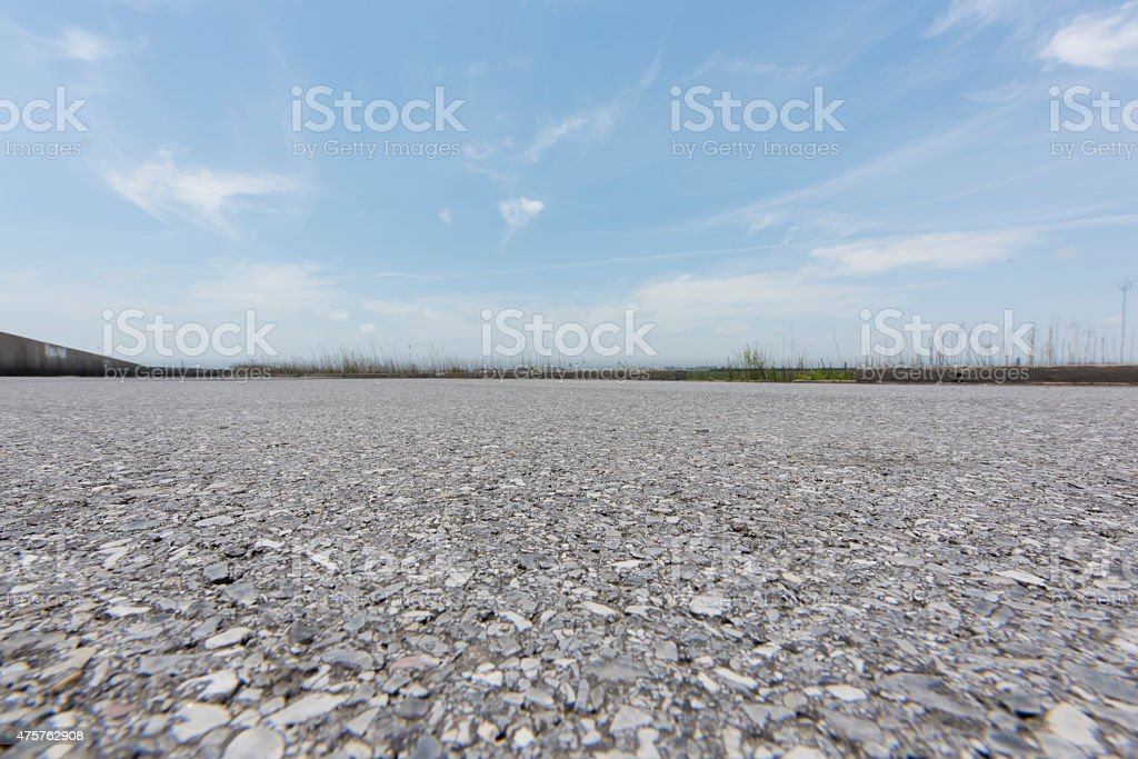 Road perspective from low angle stock photo
