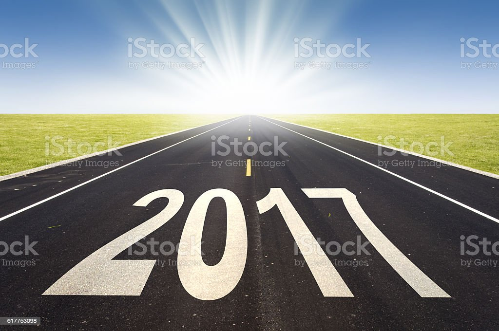 2017 road perspective with rising sun stock photo