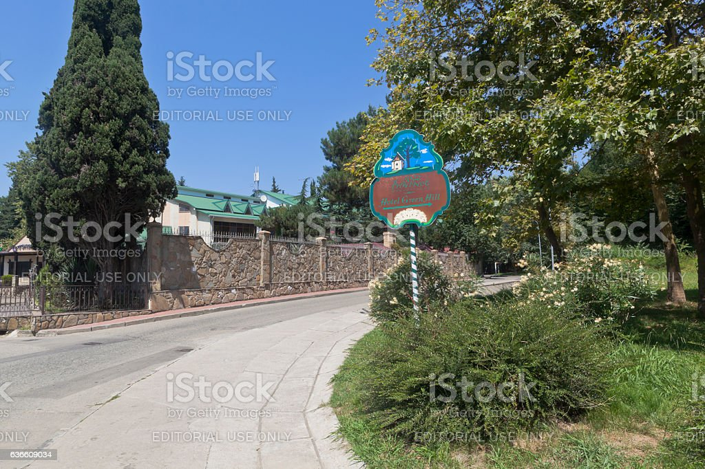 Road pointer Hotel 'Green Hill' in the resort village Adler stock photo