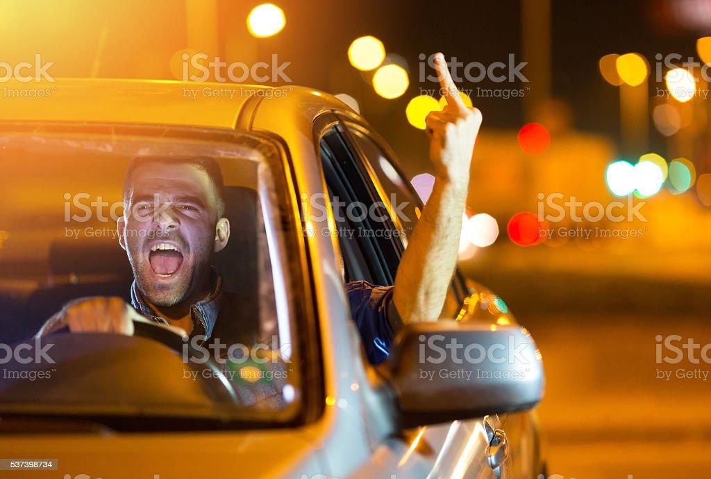 Road rage at night stock photo