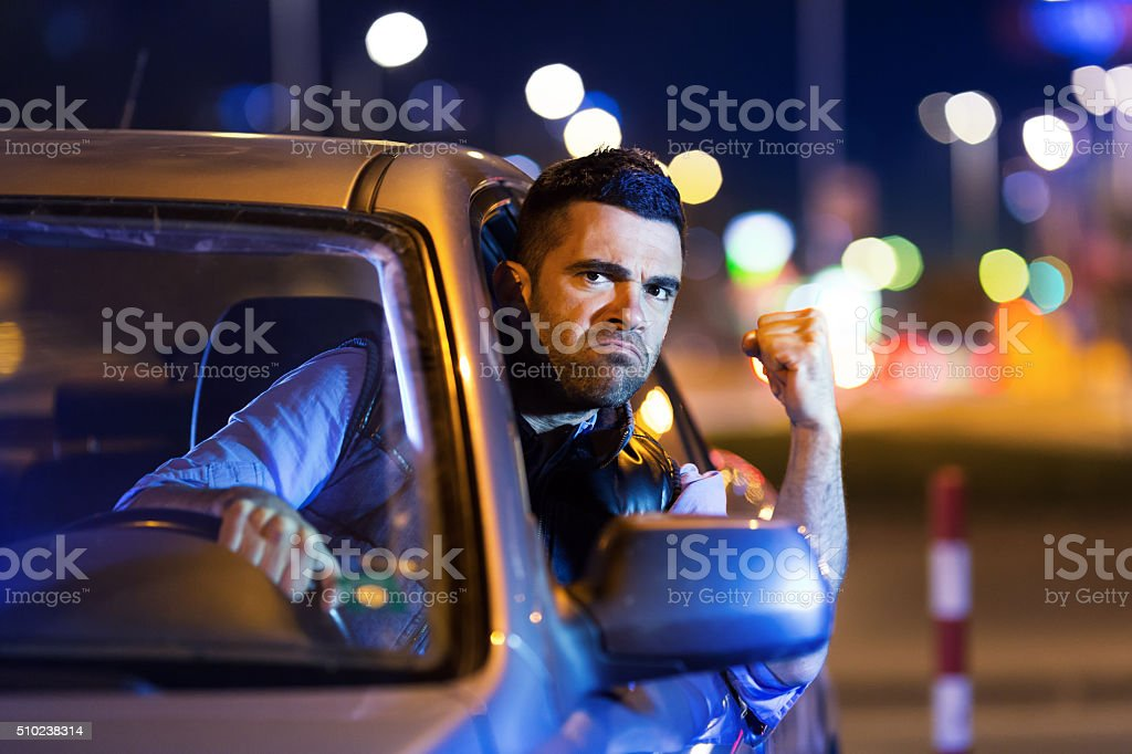 Road rage by night in the city stock photo