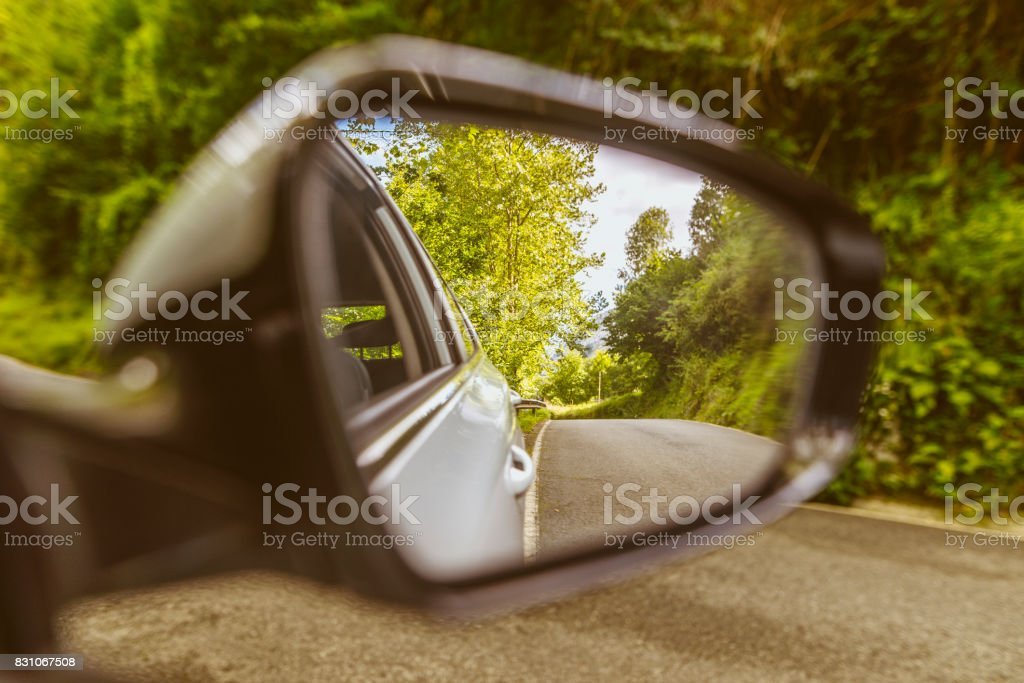 Road reflection on car mirror stock photo