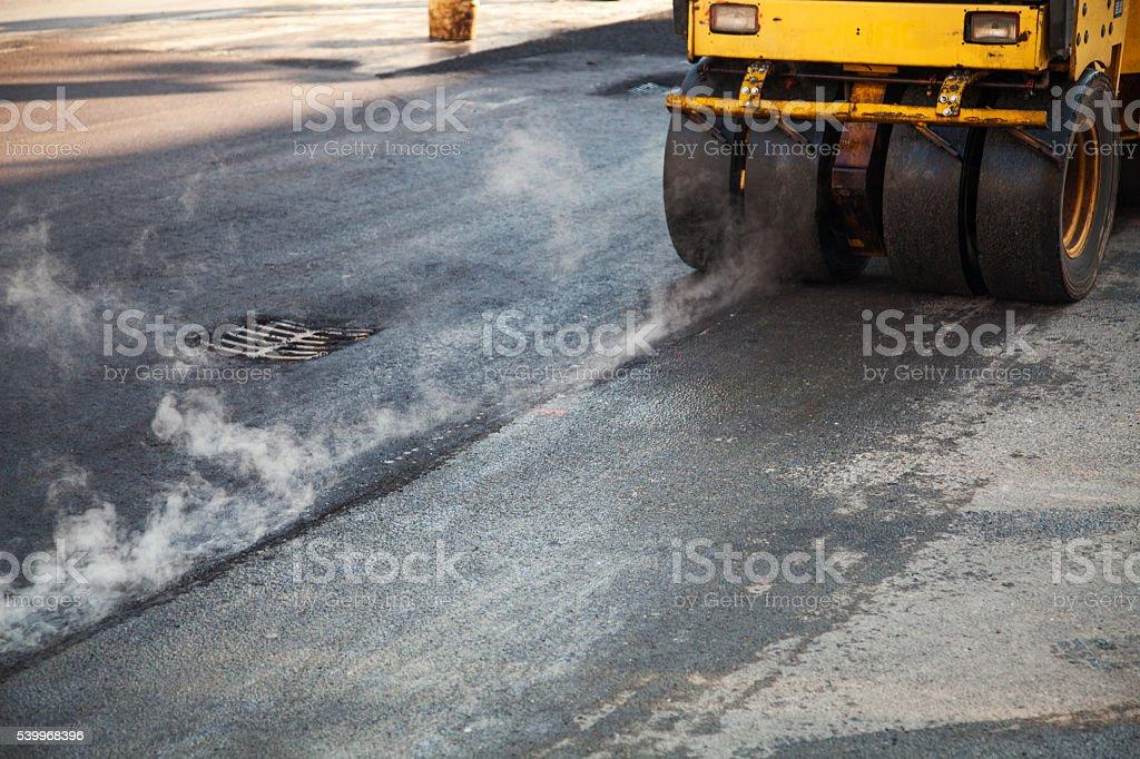Road repairs, new layer of asphalt stock photo