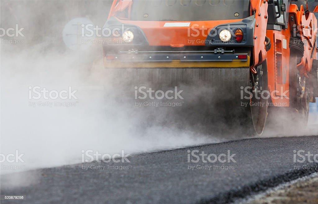 Road roller flattening new asphalt stock photo