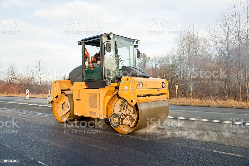 Road roller in action stock photo