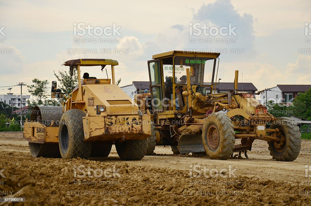Machine and people working at construction site in Nonthaburi,...