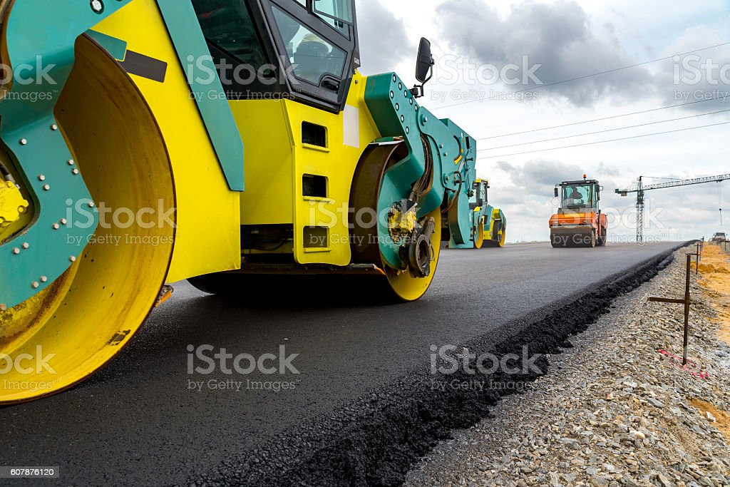 Road roller working on the construction site stock photo