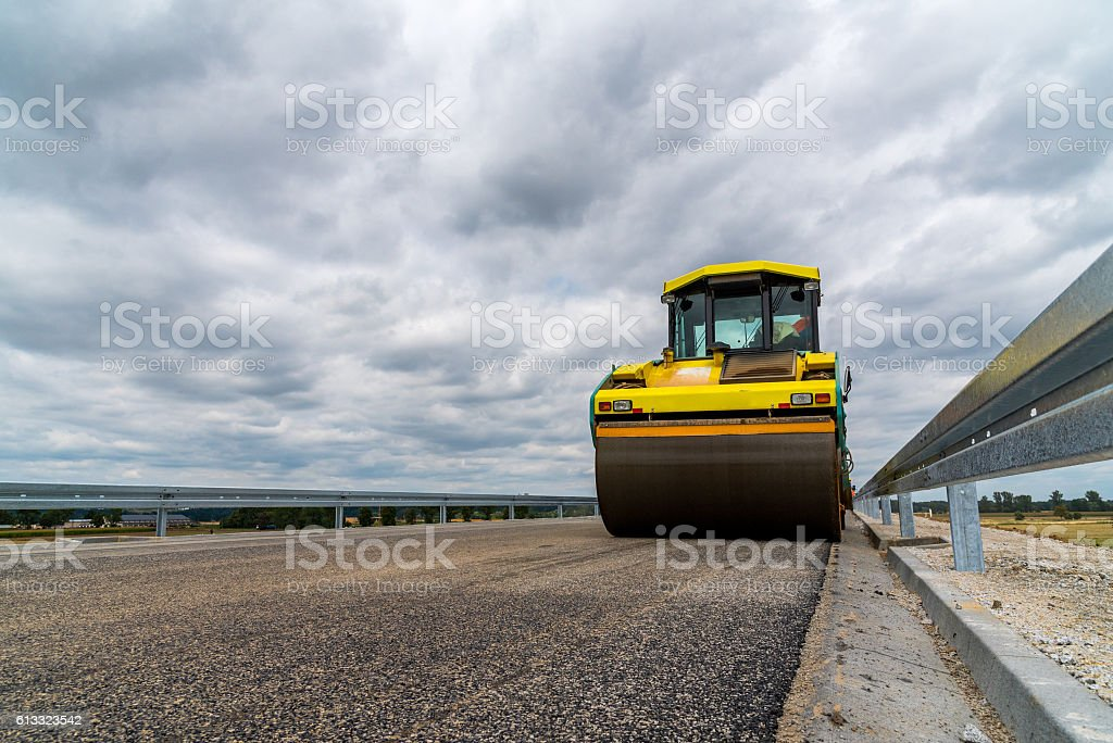 Close view on the road roller working on the new road construction...
