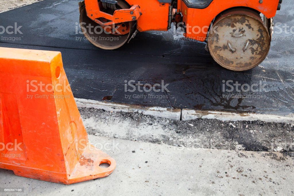Road roller working on the road construction stock photo