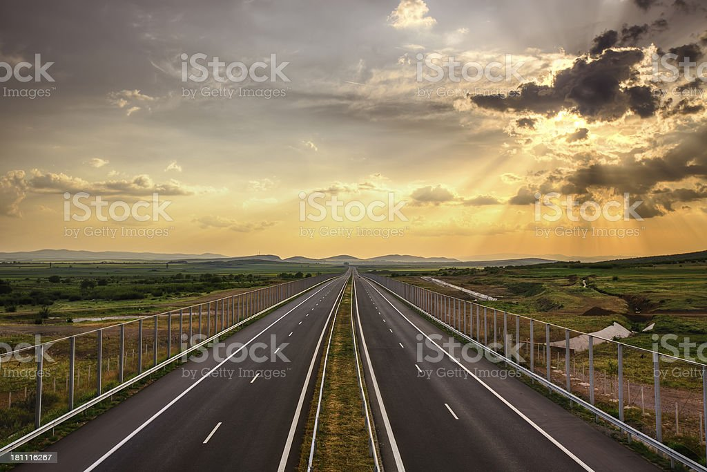 Road Running Through Fields royalty-free stock photo