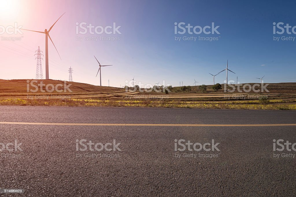 Road Running Through the windmill Fields stock photo
