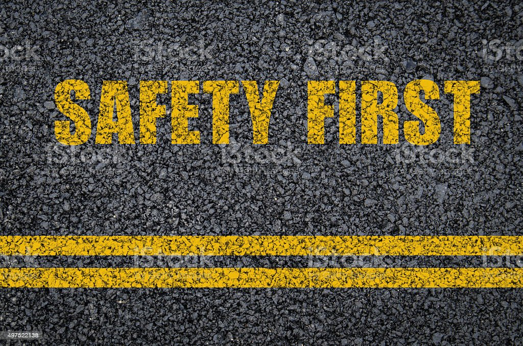 Road safety concept: Safety first on asphalt with centre lines stock photo