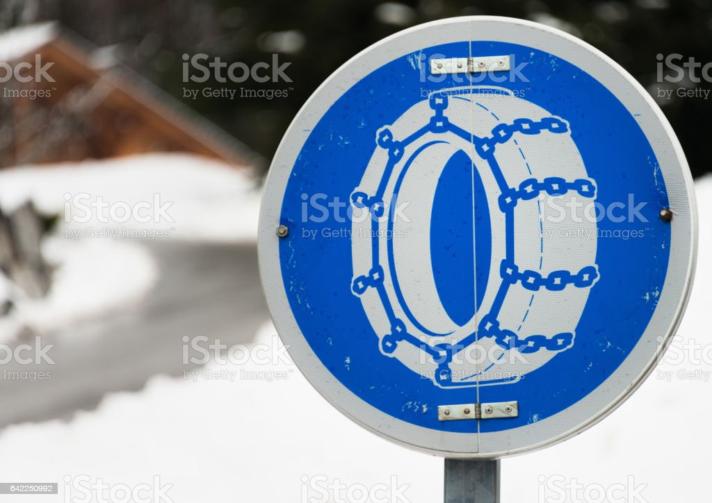 Road safety: Snow chains needed sign stock photo