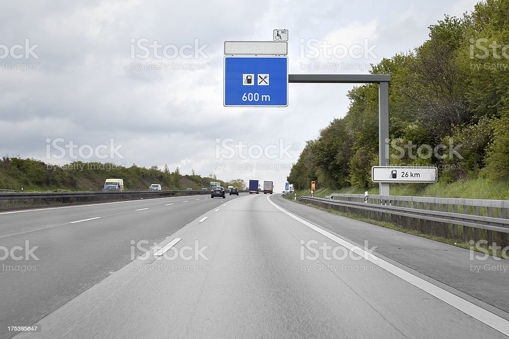 Road sign above the highway, petrol station and rest area royalty-free stock photo