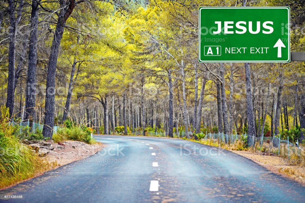 JESUS road sign against clear blue sky stock photo