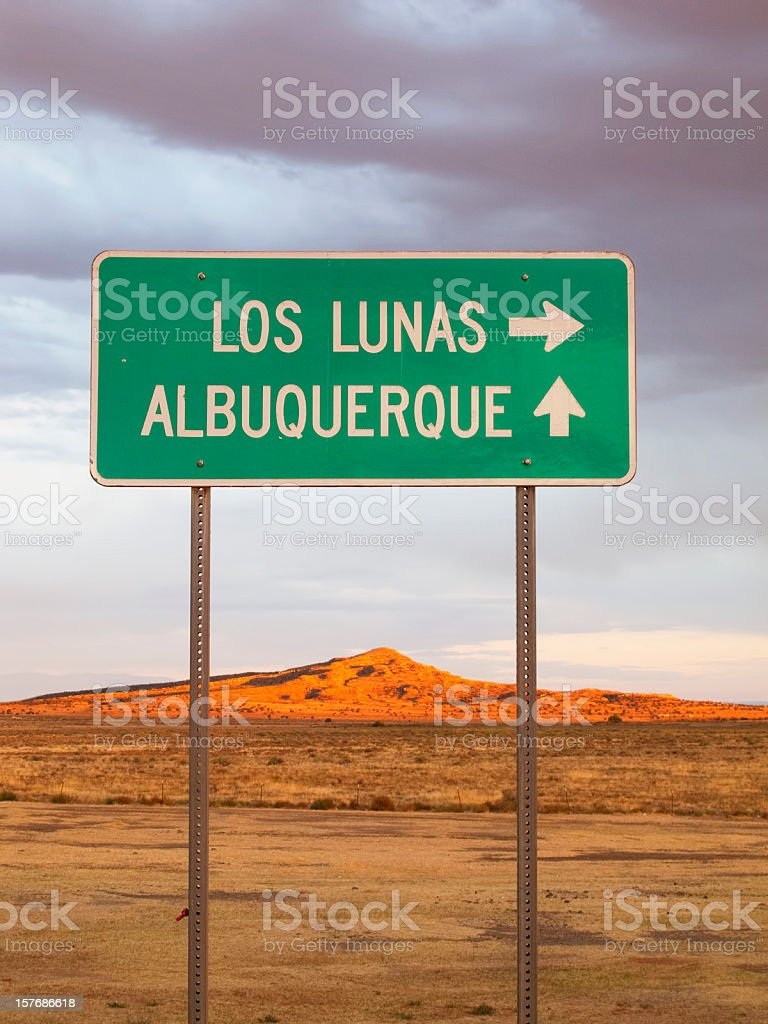 road sign and desert sunset landscape royalty-free stock photo