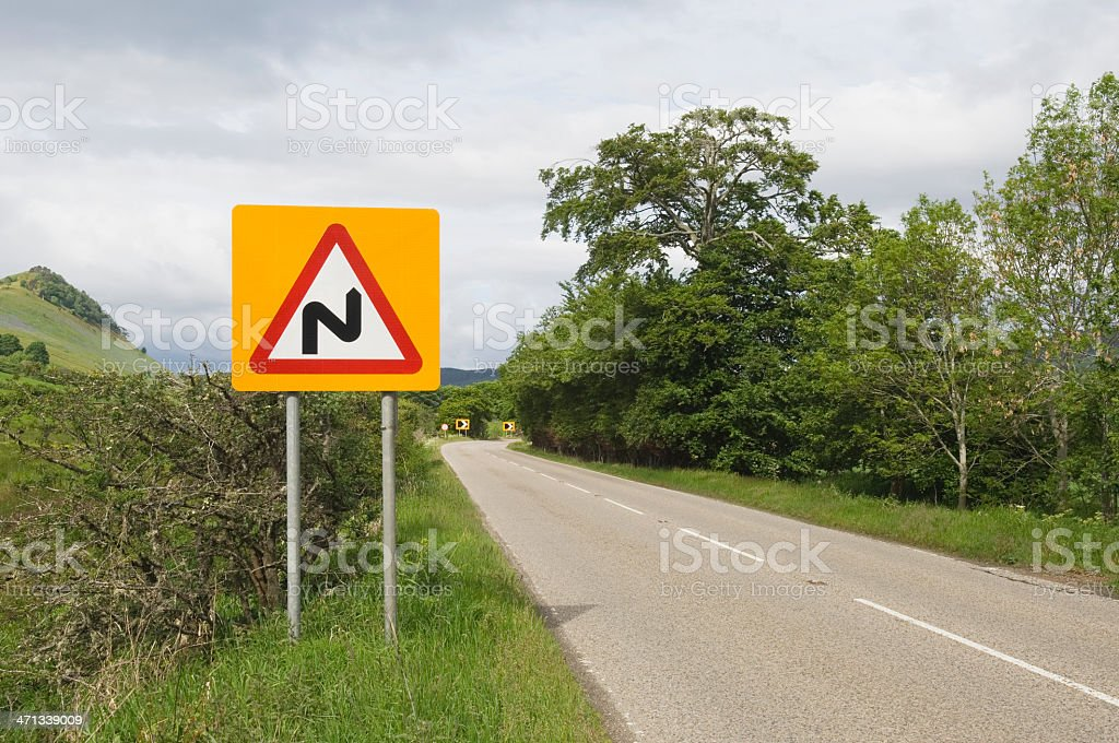 Road sign - 'Bends ahead' stock photo