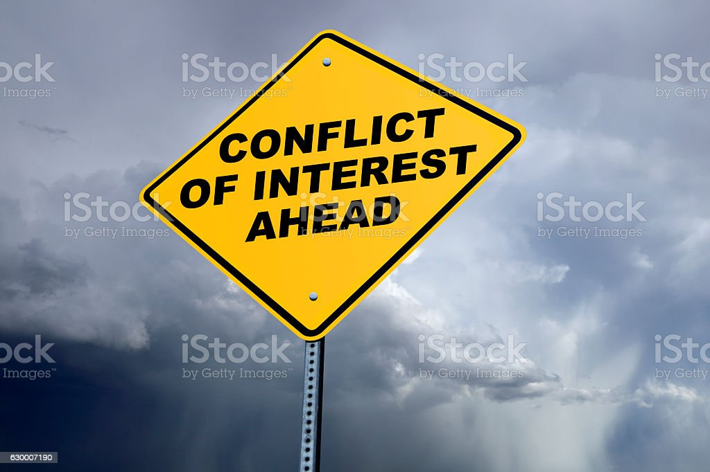 Road Sign Declaring Conflict Of Interest Ahead stock photo