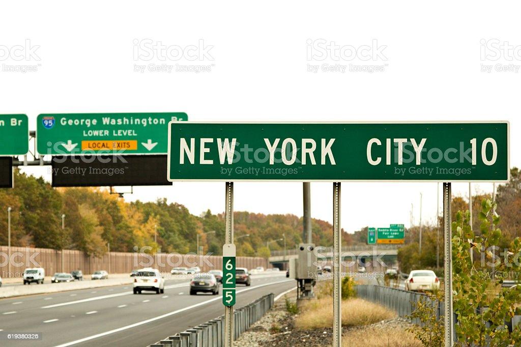Road sign designating Ten Miles to New York City stock photo