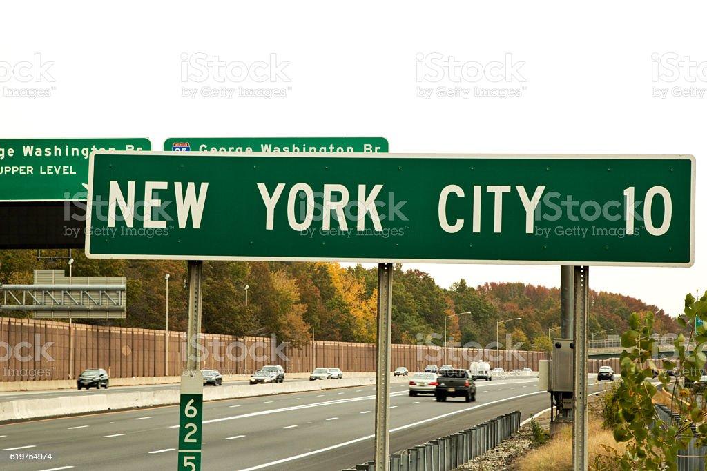 Road sign designation of Ten Miles to New York City stock photo