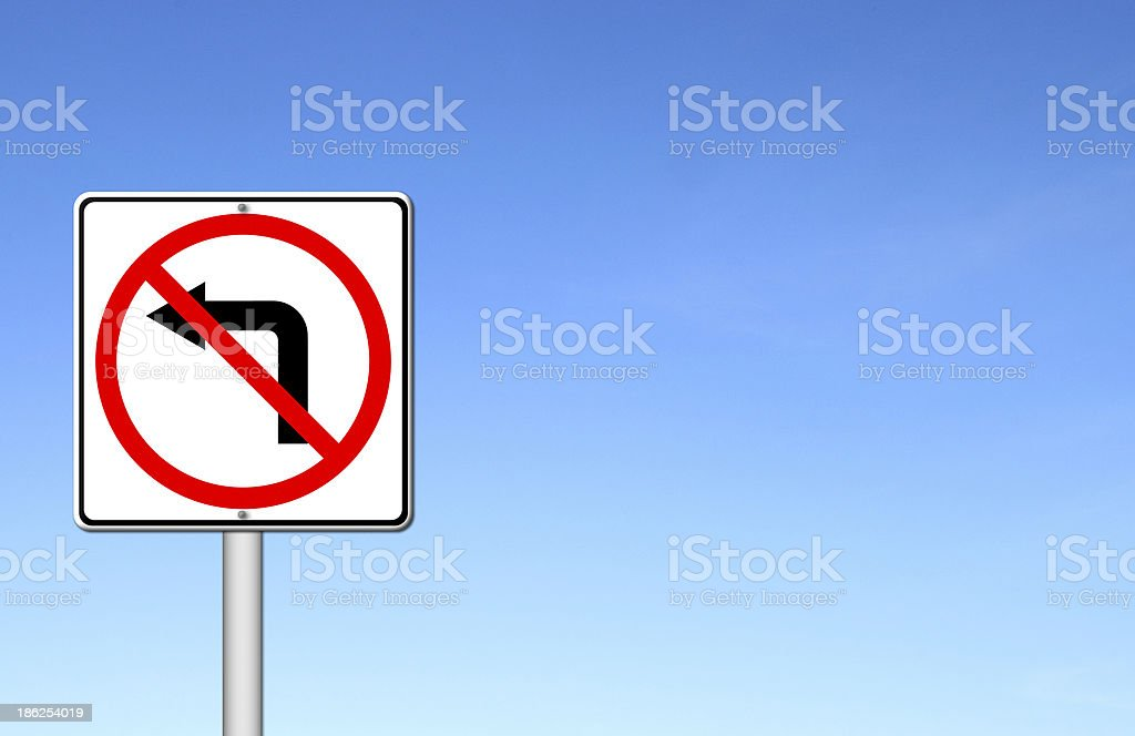 Road sign don't turn left over blue sky royalty-free stock photo