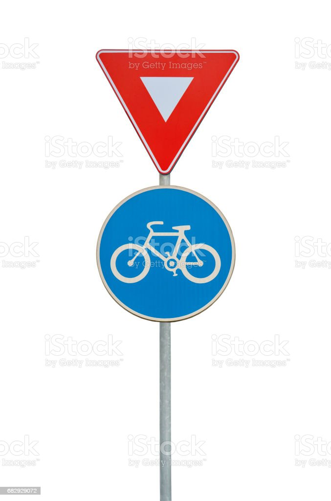 Road sign for a bicycle lane and triangle isolated on white stock photo