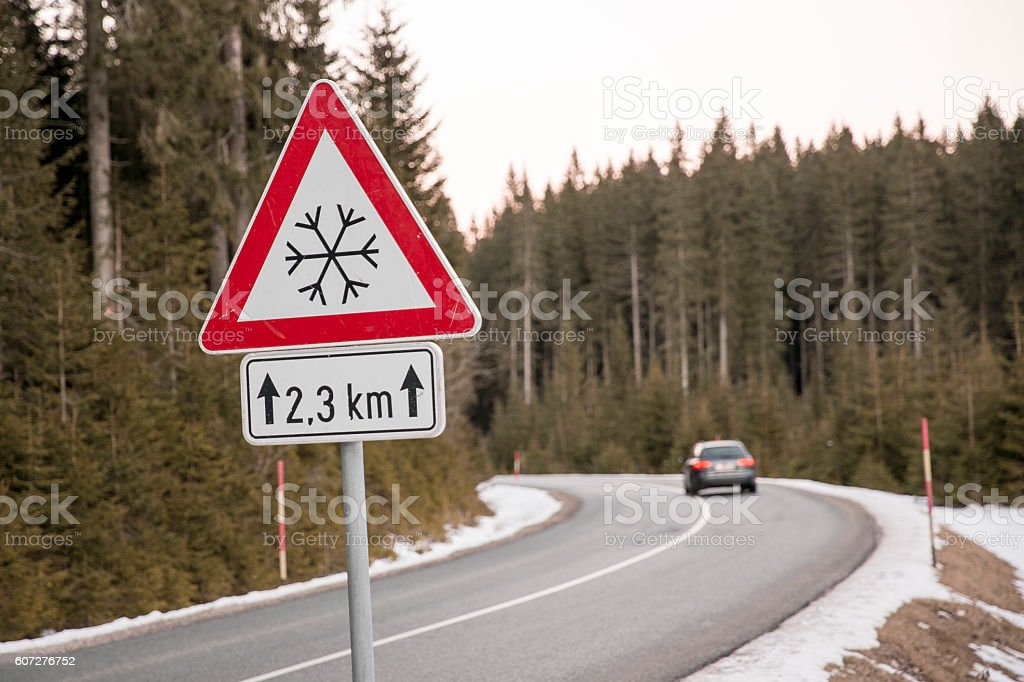 Road sign for snowy conditions stock photo