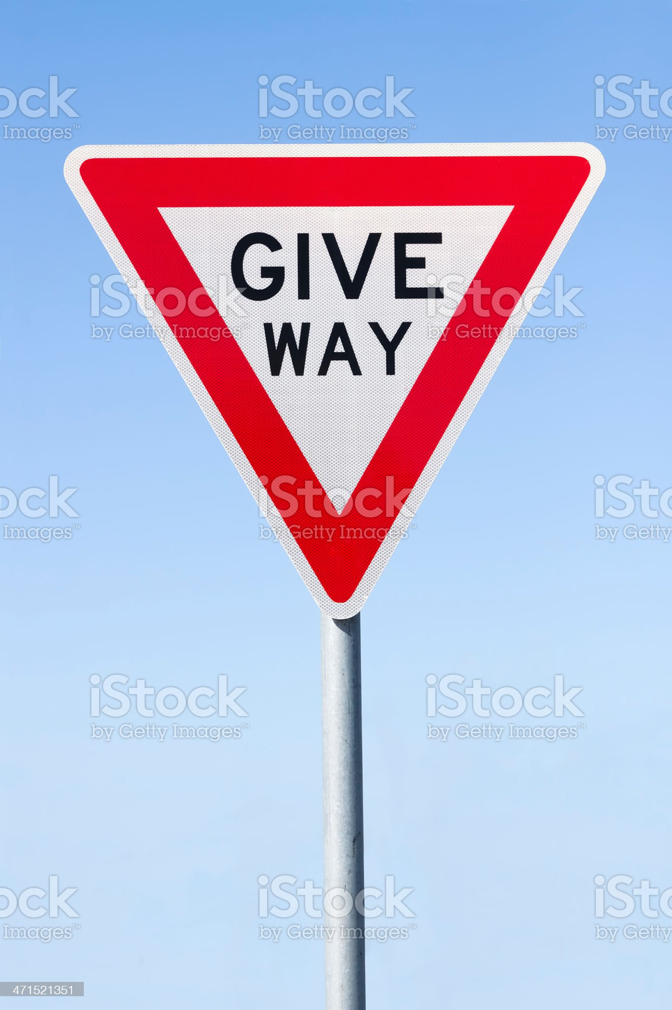 Road sign 'Give way'  against blue sky, copy space royalty-free stock photo